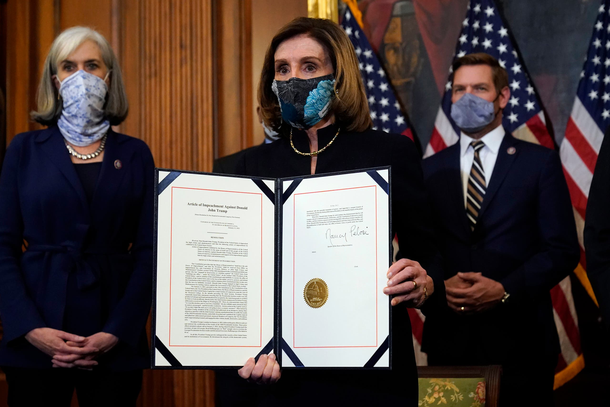 House Speaker Nancy Pelosi of Calif., displays the signed article of impeachment against President Donald Trump in an engrossment ceremony before transmission to the Senate for trial on Capitol Hill, in Washington, Wednesday, Jan. 13, 2021. (AP)