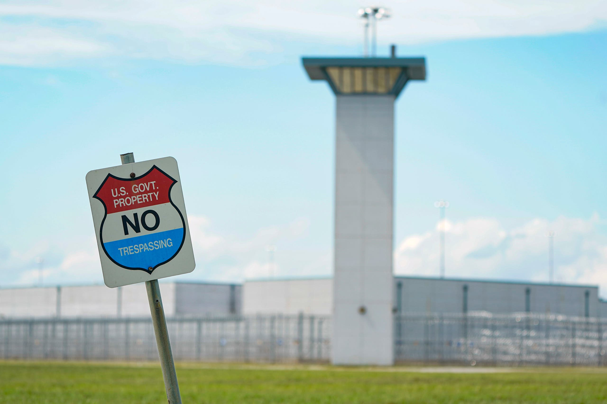 A no trespassing sign is displayed outside the federal prison complex in Terre Haute, Ind. (AP)