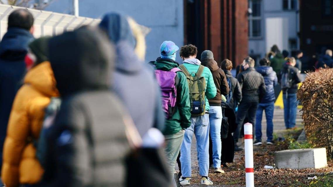 People queue at a walk-in COVID-19 testing centre at Wilhelmstrasse, amid the coronavirus disease (COVID-19) pandemic, in Berlin, Germany. (Reuters)