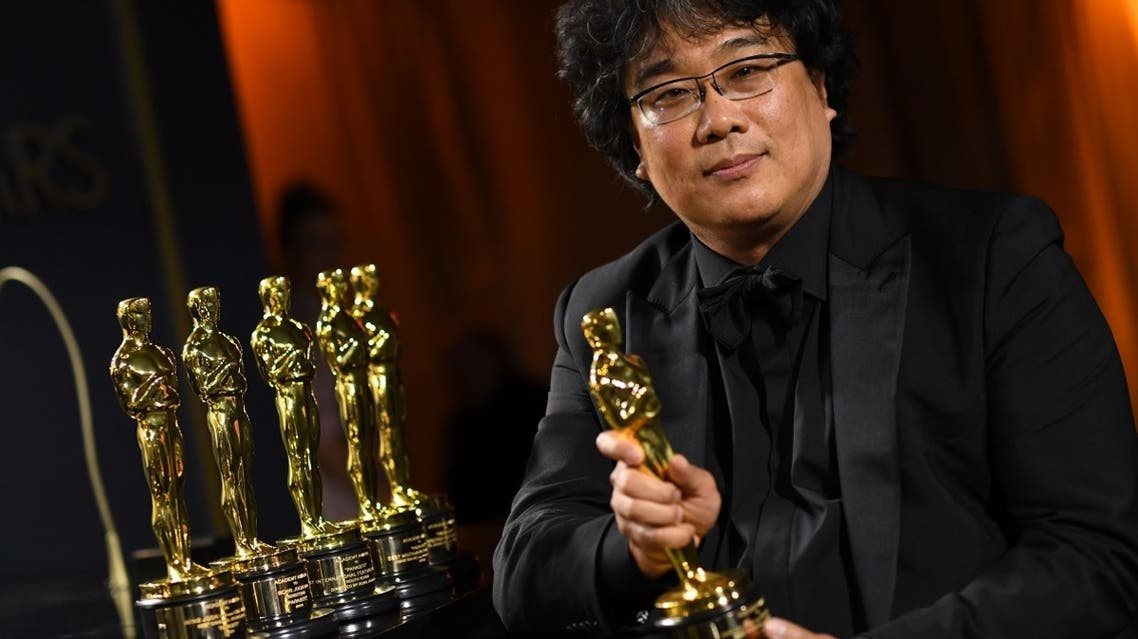South Korean film director Bong Joon Ho poses with his engraved awards as he attends the 92nd Oscars Governors Ball at the Hollywood & Highland Center in Hollywood, California, on February 10, 2020. (AFP)