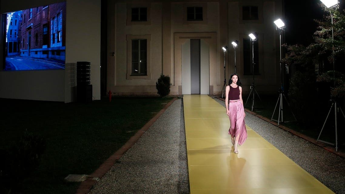 Model Mariacarla Boscono wears a creation as part of the Salvatore Ferragamo 2021 women's spring-summer ready-to-wear collection during the fashion week in Milan, Italy. (File photo: AP)