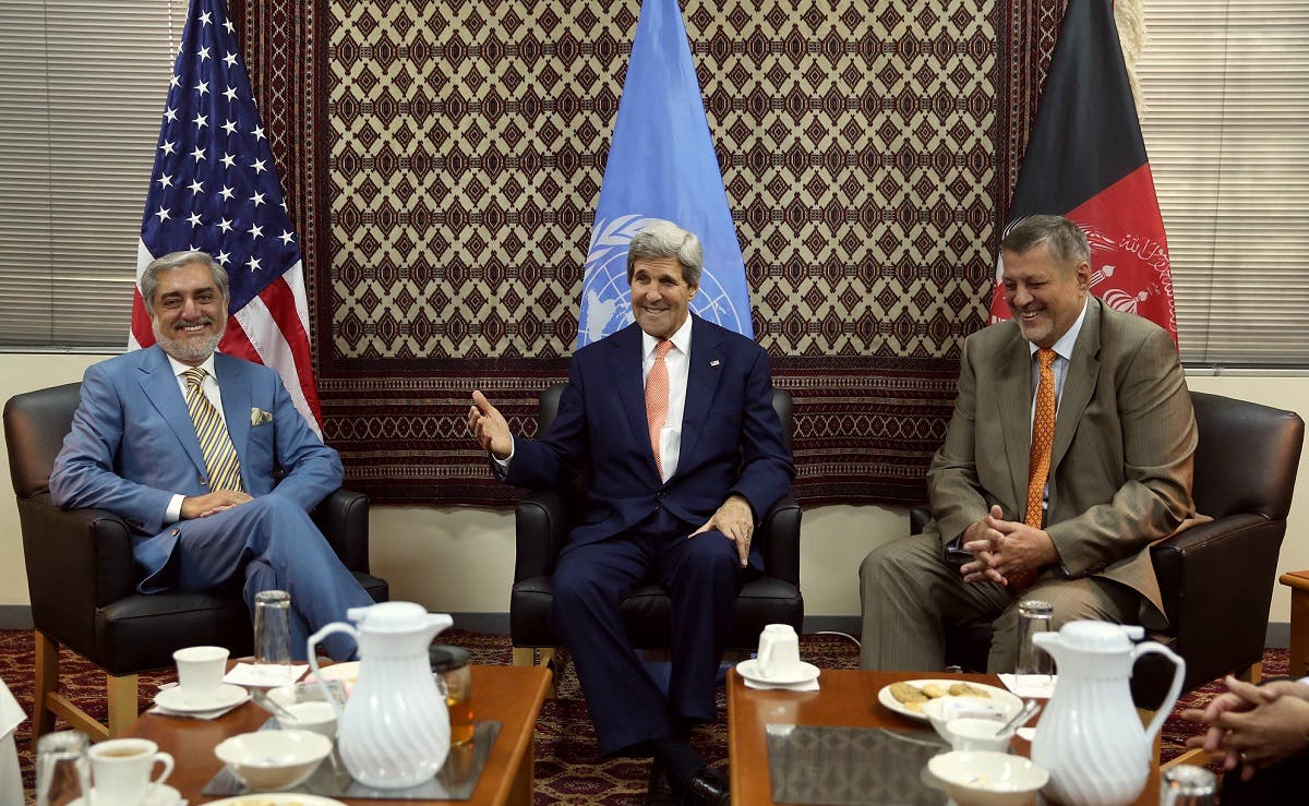 Then-US Secretary of State John Kerry, center, talks as Afghan presidential candidate Abdullah Abdullah, left, and Jan Kubis, the UN Secretary-General's special representative, right, listen during a meeting at the US embassy in Kabul, Aug. 8, 2014. (AP)