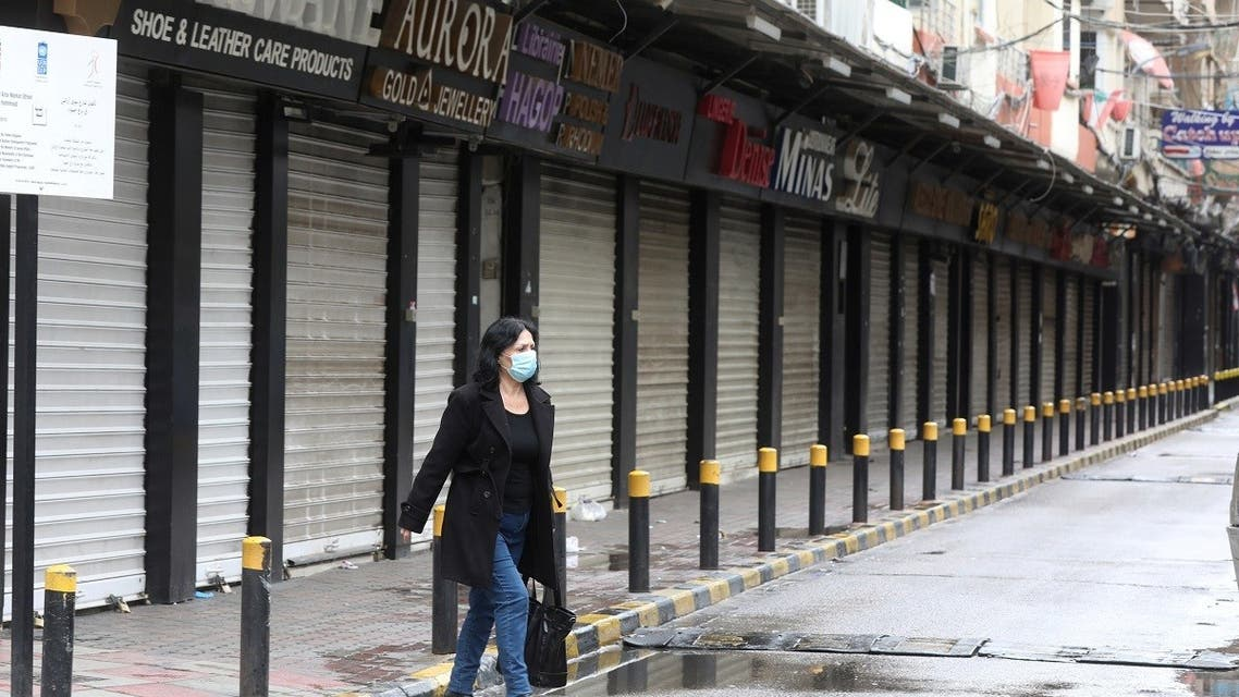 A woman wearing a face mask walks along a street, as Lebanon tightened lockdown and introduced a 24-hour curfew to curb the spread the coronavirus disease (COVID-19) in Beirut, Lebanon. (Reuters)