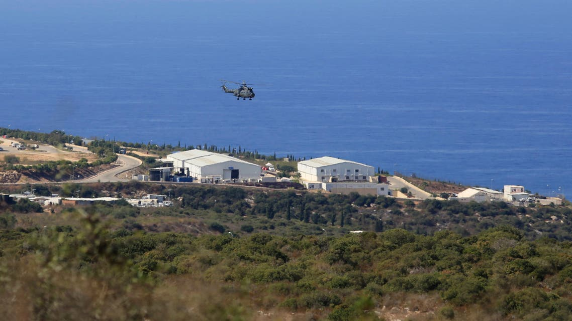 A helicopter flies over a base of the U.N. peacekeeping force, in the southern town of Naqoura, Lebanon. (File photo: AP)