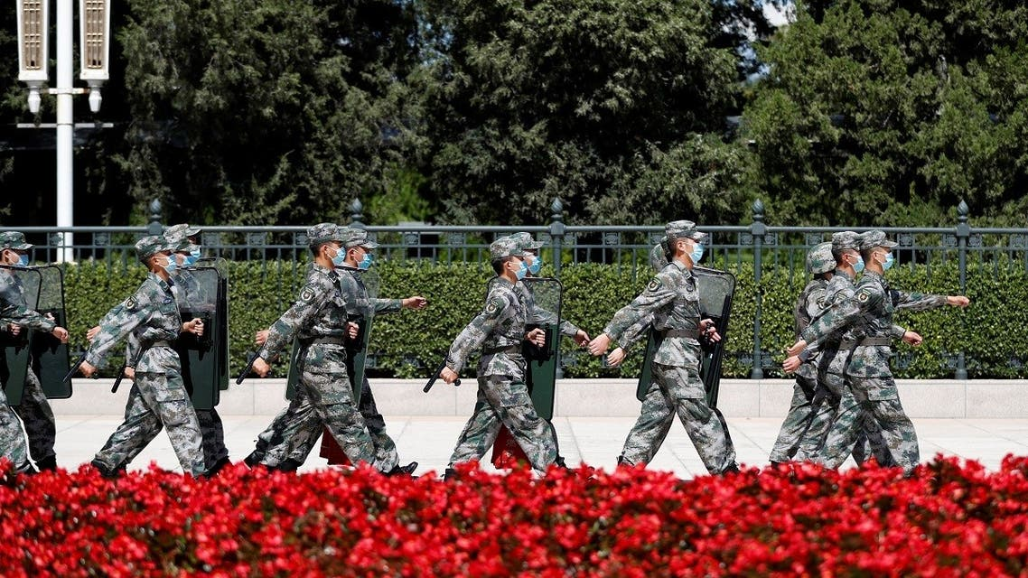 Soldiers of the People's Liberation Army (PLA) march outside the Great Hall of the People in Beijing. (Reuters)