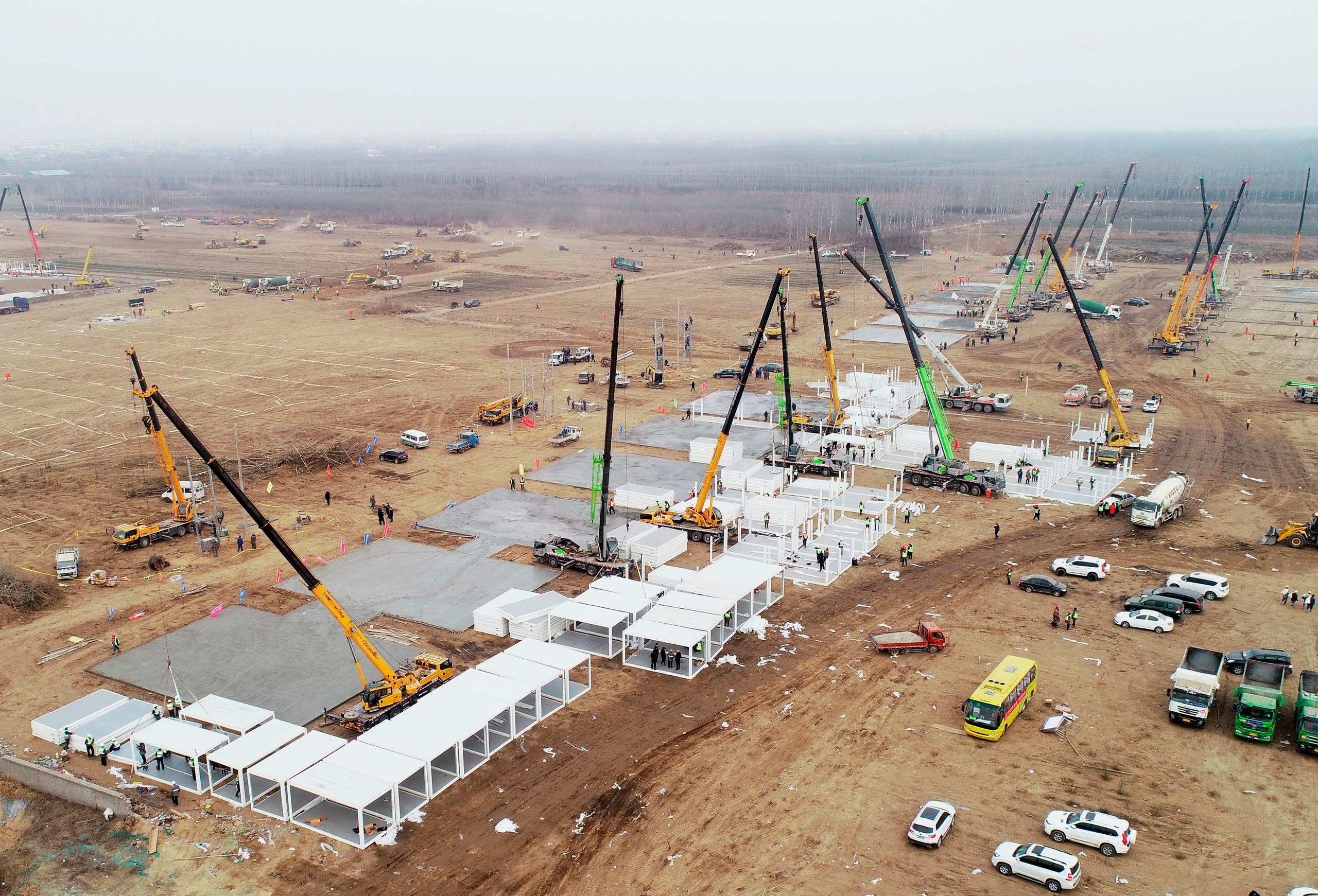 In this aerial photo released by China's Xinhua News Agency, workers build a large centralized quarantine facility in Shijiazhuang in northern China's Hebei Province, Thursday, Jan. 14, 2021. (AP)
