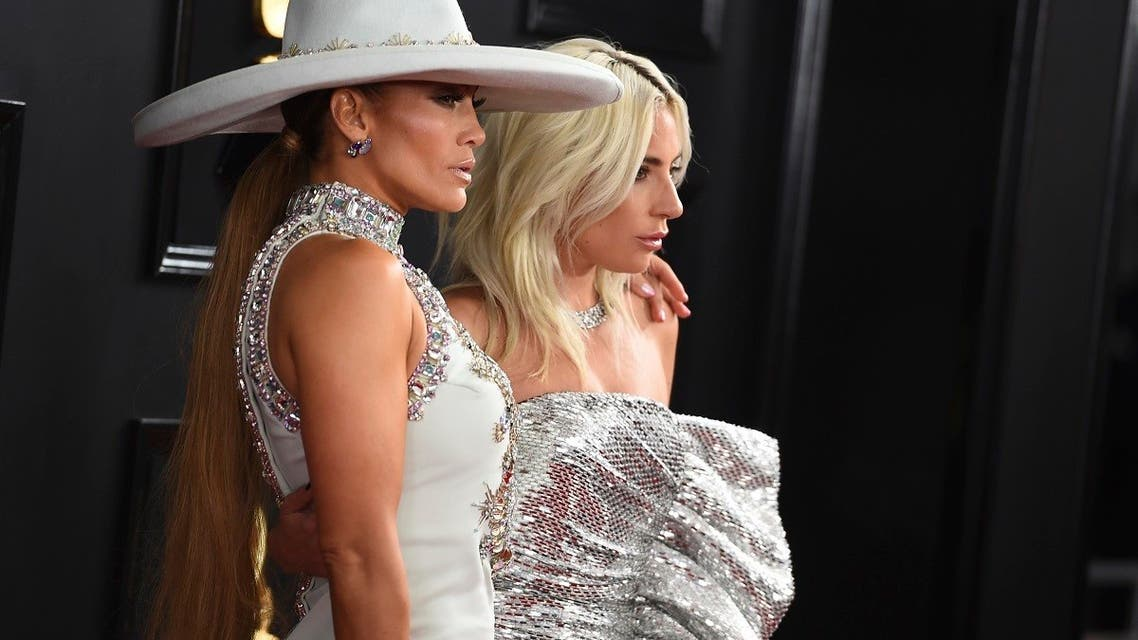 Jennifer Lopez, left, and Lady Gaga arrive at the 61st annual Grammy Awards at the Staples Center on Sunday, Feb. 10, 2019, in Los Angeles. (AP)