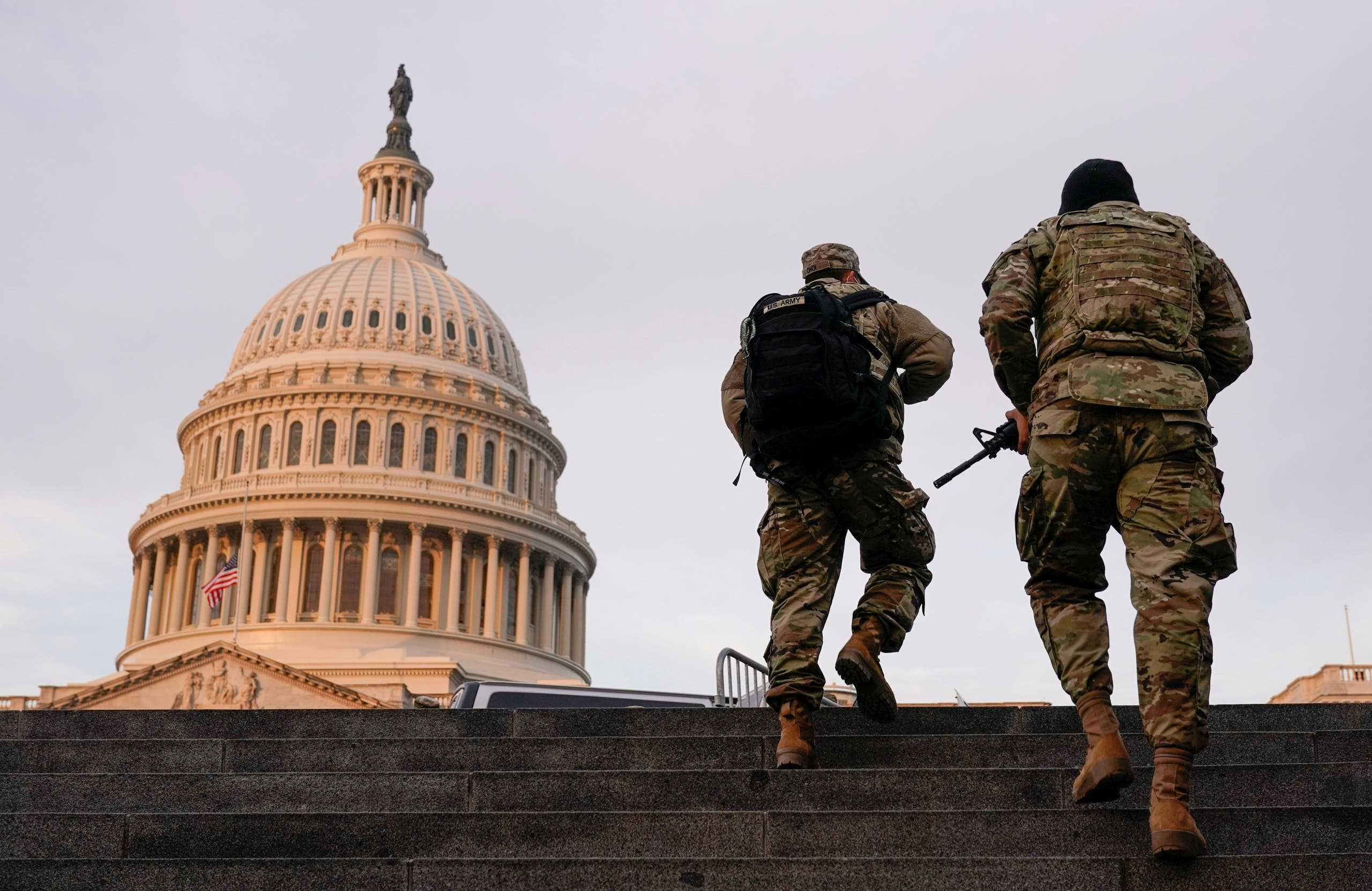 National Guard members walk at the Capitol, in Washington, US, January 15, 2021. (Reuters)