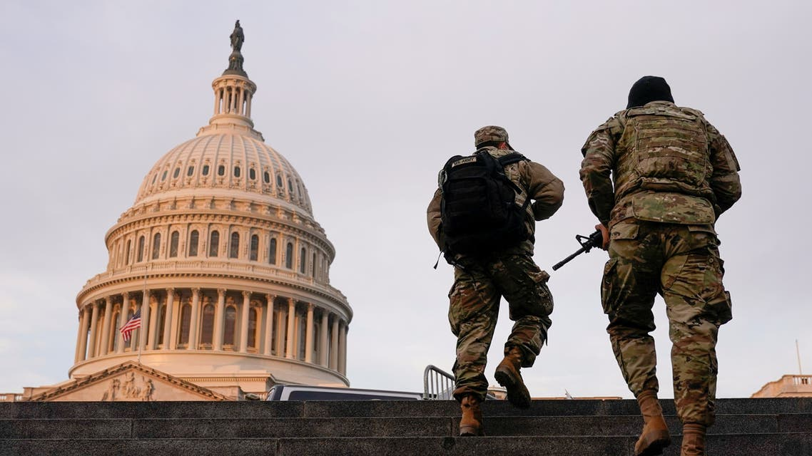 National Guard members walk at the Capitol, in Washington, U.S., January 15, 2021. (Reuters)