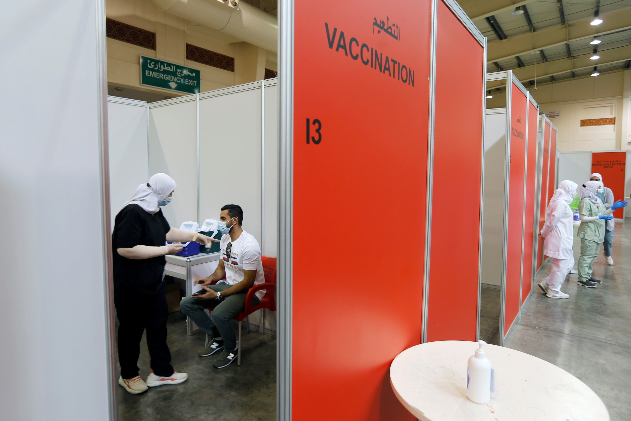 A Bahraini man waits to get a dose of a coronavirus disease (COVID-19) vaccine, at Bahrain International Exhibition & Convention Centre (BIECC), in Manama. (Reuters)