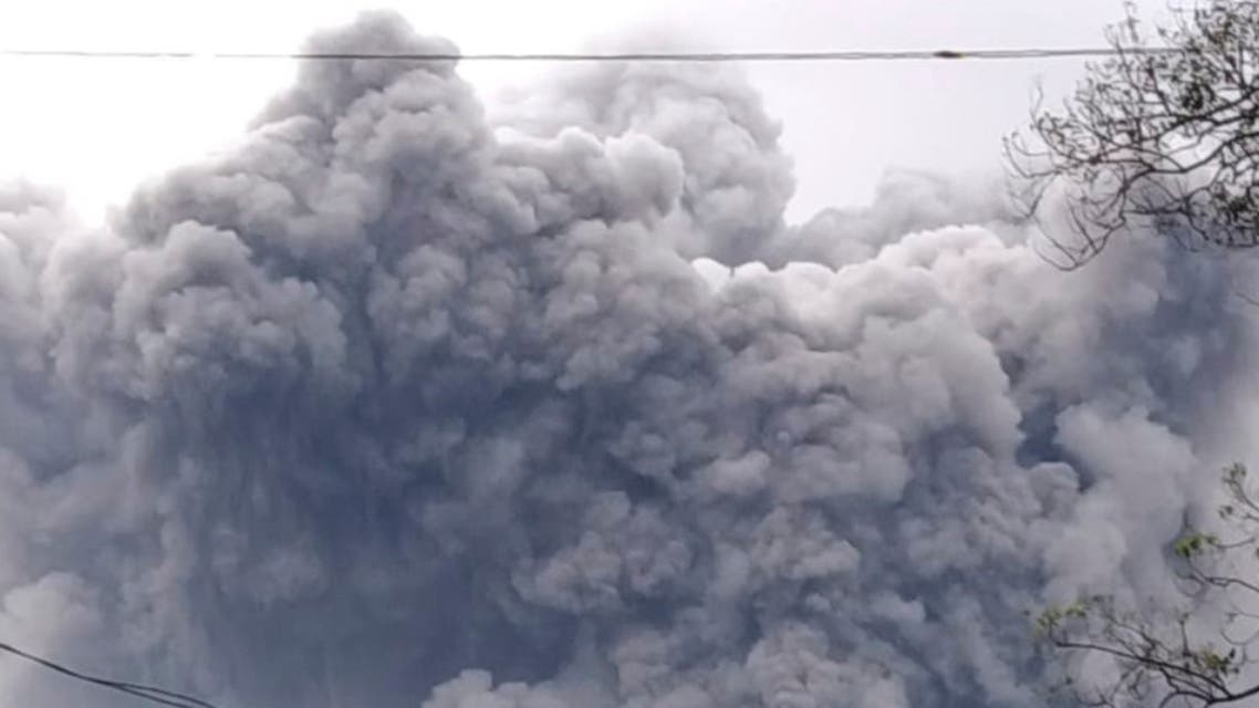In this photo released by Indonesia's National Disaster Mitigation Agency (BNPB) Mount Semeru spews volcanic material during an eruption in Lumajang, East Java, Indonesia, Saturday, Jan. 16, 2021. The highest volcano on Indonesia's most densely populated island of Java, spewed hot clouds as far away as 4.5 kilometers (nearly 3 miles) on Saturday. (National Disaster Mitigation Agency via AP)