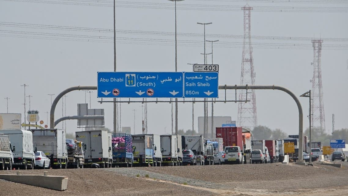 Emirati security forces man a checkpoint at the entrance of Abu Dhabi, on the highway linking Dubai to the capital. (AFP)