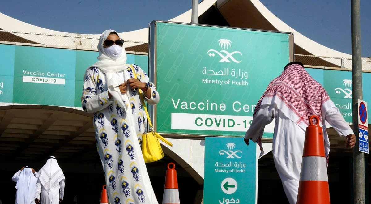 People take advantage of a new coronavirus vaccination center at the old Jeddah airport, Saudi Arabia. (AP)