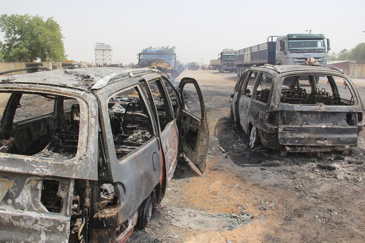In this photo taken in Auno on February 10, 2020, cars burnt down by suspected members of the Islamic State West Africa Province (ISWAP) during an attack on February 9, 2020. (Audu Marte/AFP)
