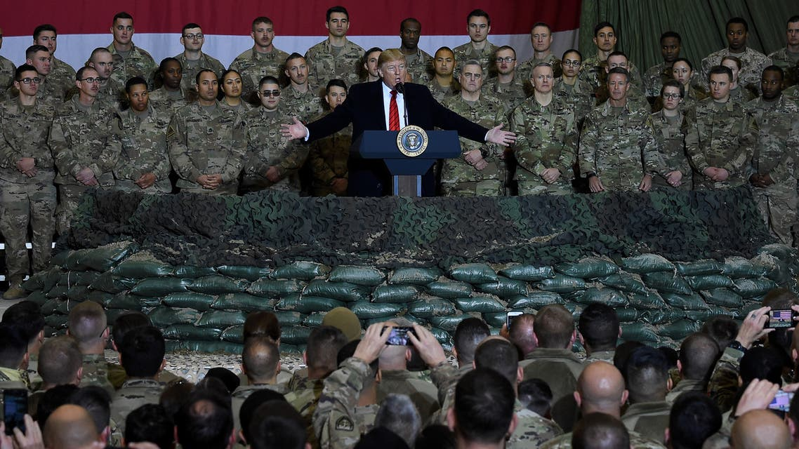 (FILES) In this file photo taken on November 28, 2019, US President Donald Trump speaks to the troops during a surprise Thanksgiving visit at Bagram Air Fieldin Afghanistan. The US military has cut troop levels in Afghanistan and Iraq to 2,500 each, their lowest levels in the nearly two decades since the wars began, the Pentagon announced on January 15, 2021.