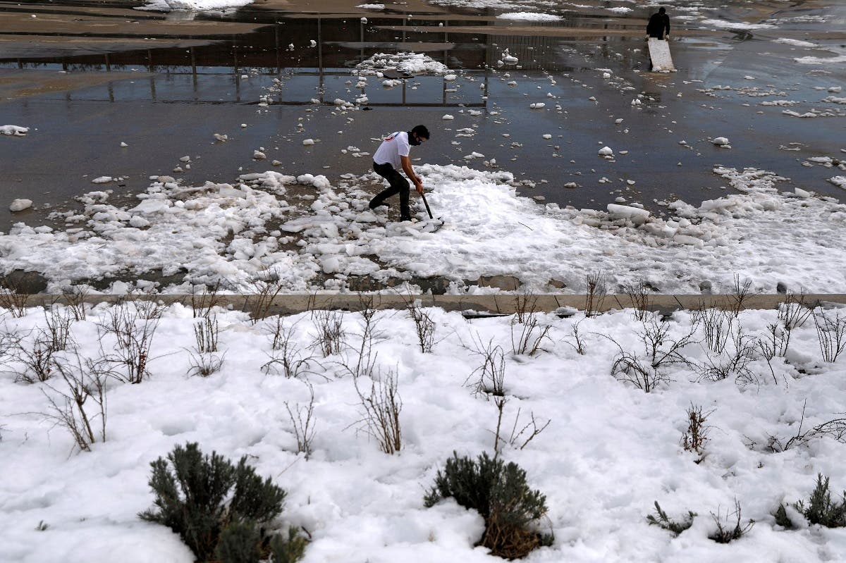 Members of a skating club clear ice and snow from the public area where they train after heavy snowfall in Madrid, Spain. (Reuters)