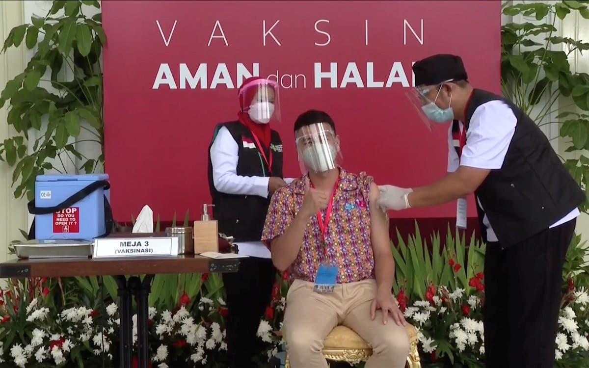 Indonesian influencer Raffi Ahmad receives a shot of the coronavirus disease (COVID-19) vaccine at the Merdeka Palace in Jakarta. ( Indonesian Presidential Palace/Reuters)
