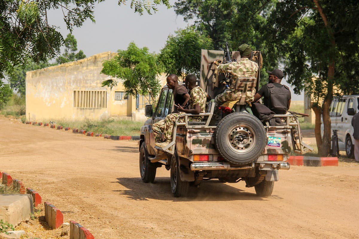 Nigerian Army soldiers are seen driving on a military vehicle in Ngamdu, Nigeria, on November 3, 2020. (Audu Marte/AFP)