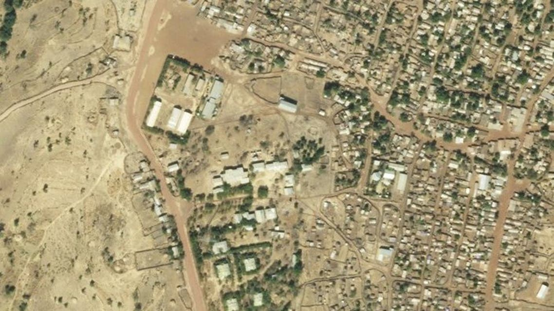 This satellite photo provided on Sunday January 17, 2021 by Planet Labs, Inc. shows the destruction of UN World Food Program warehouses at the Shimelba refugee camp in Ethiopia's Tigray region on January 5, 2021, bottom center left, and before it was destroyed on December 10, 2020, top. (2021 Planet Labs, Inc via AP)