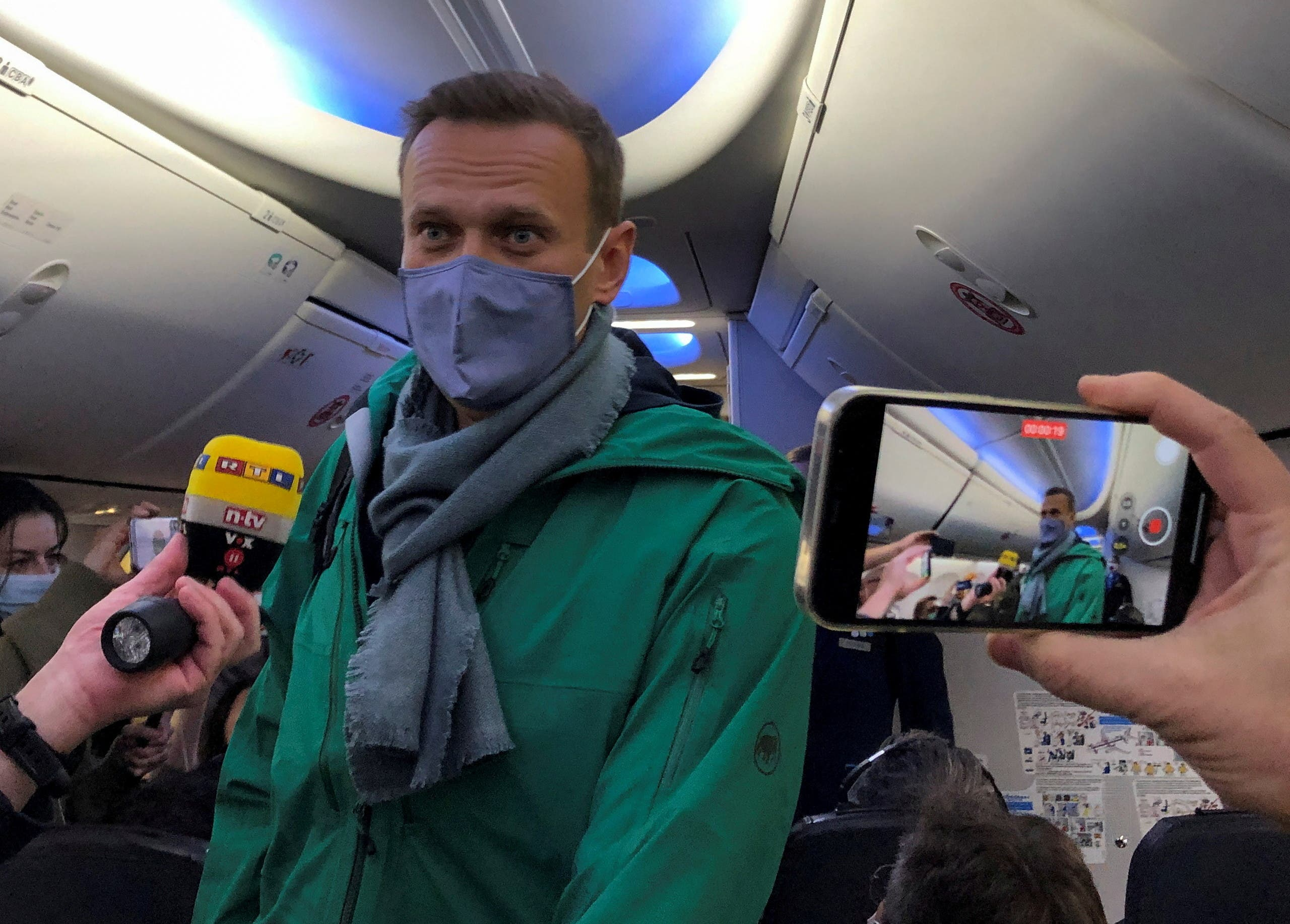 Russian opposition leader Alexei Navalny is seen on board a plane before the departure for the Russian capital Moscow at an airport in Berlin, Germany January 17, 2021. (Reuters)