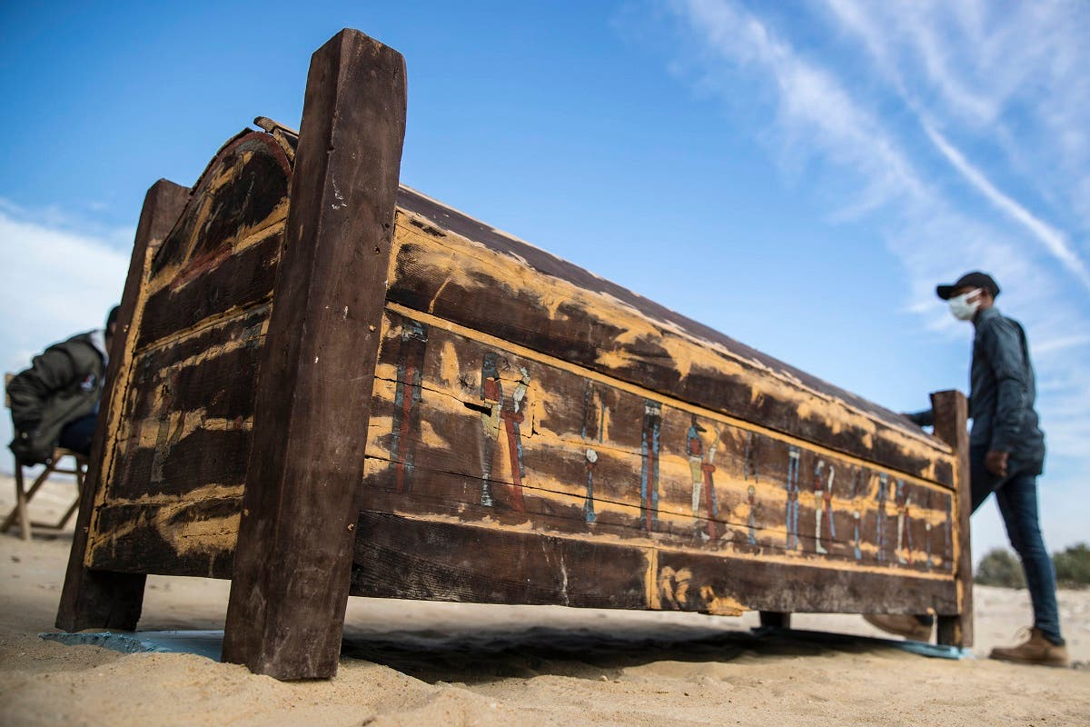 An adorned wooden sarcophagus is displayed at Egypt's Saqqara necropolis south of Cairo, on January 17, 2021. (Khaled Desouki/AFP)