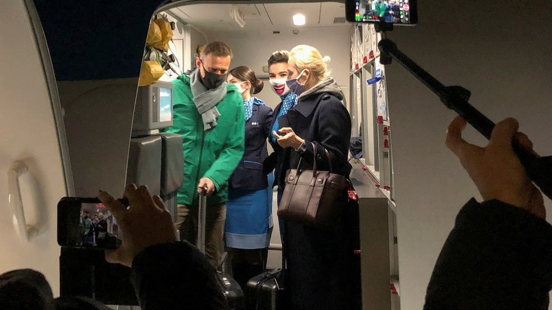Russian opposition leader Alexei Navalny and his wife Yulia Navalnaya walk out of a plane after arriving at Sheremetyevo airport in Moscow, Russia January 17, 2021. (Reuters/Polina Ivanova)