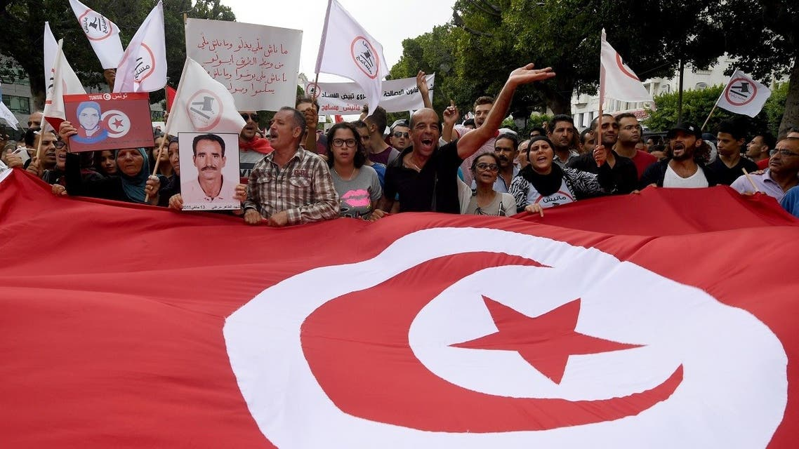 Tunisians take part in a demonstration on September 16, 2017 in Tunis to protest the parliament's passing of an amnesty law for officials accused of corruption under toppled President Ben Ali. (Fethi Belaid/AFP)