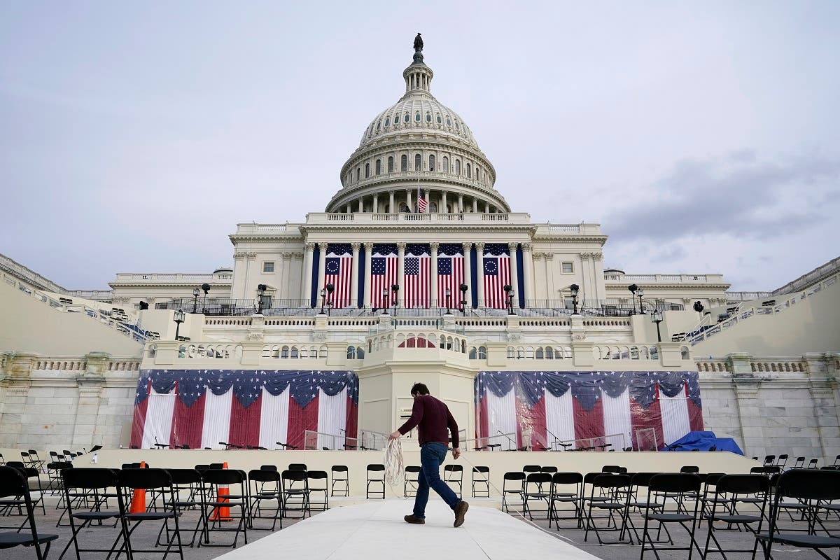 A worker pulls cables as preparations take place for President-elect Joe Biden's inauguration ceremony at the US Capitol in Washington. (AP)