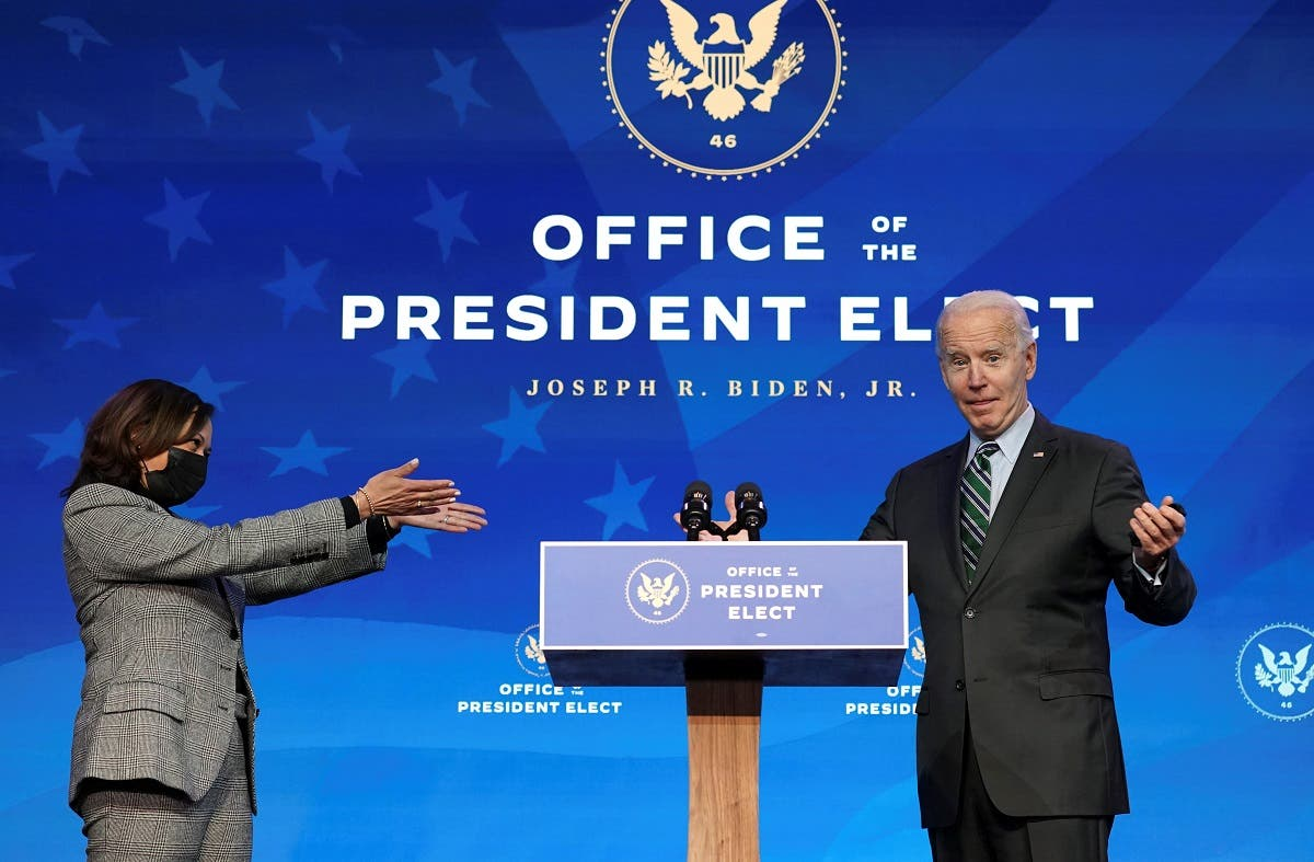 US Vice President-elect Kamala Harris gestures toward President-elect Joe Biden after he introduced key members of his White House science team at his transition headquarters in Wilmington, Delaware, US. (Reuters)