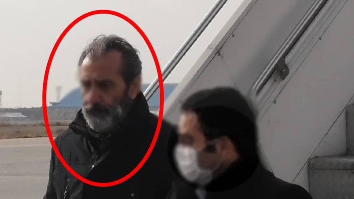 Photos published by Iran's state-run YJC news agency of Emad Sharghi being arrested in what appears to be an airport.