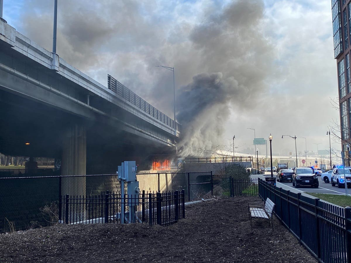 A fire burns under a bridge in Washington, DC, Jan. 18, 2021, in this picture obtained from social media. (Reuters)