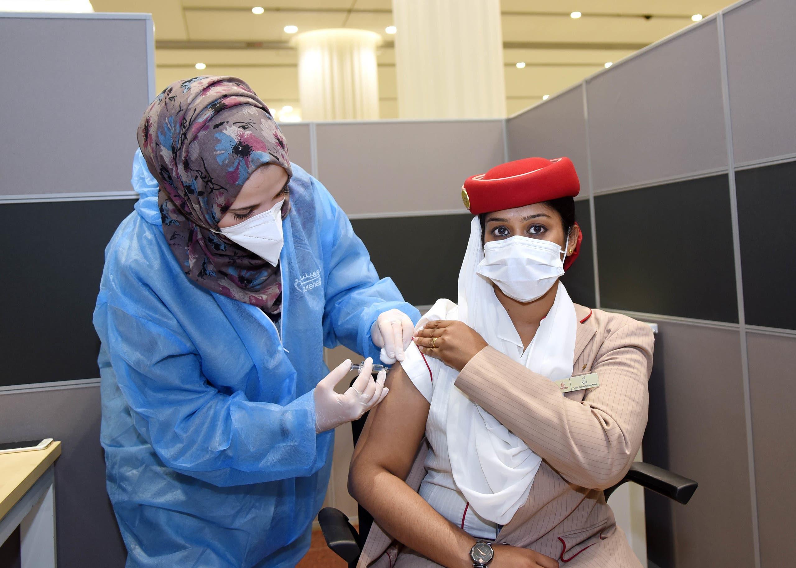 Emirates flight attendant gets the COVID-19 (coronavirus) vaccine in Dubai, United Arab Emirates. (Emirates)