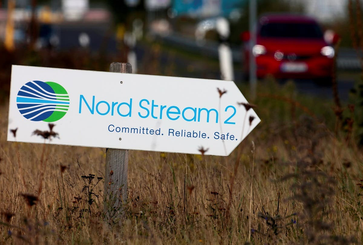 A road sign directs traffic towards the Nord Stream 2 gas line landfall facility entrance in Lubmin, Germany, Sept. 10, 2020. (Reuters)