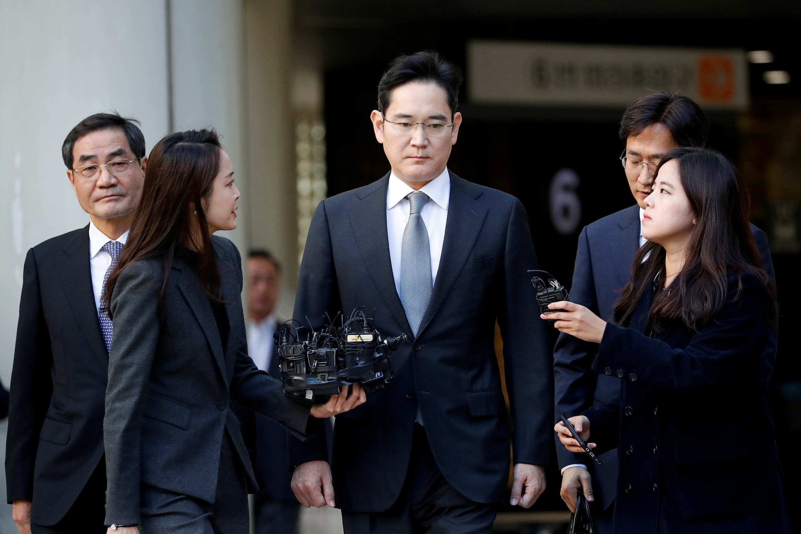 Samsung Electronics Vice Chairman, Jay Y. Lee, leaves the Seoul high court in Seoul. (Reuters)
