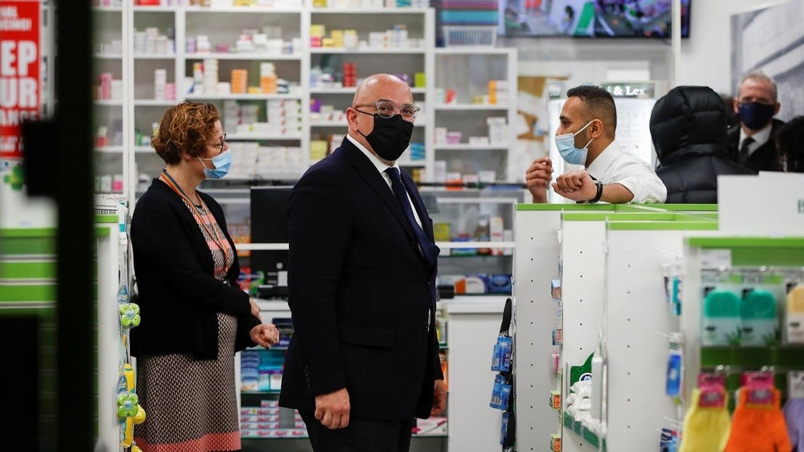 Minister for COVID-19  Vaccine Deployment Nadhim Zahawi visits the Cullimore Chemist, amid the coronavirus outbreak, in Edgware, London, Britain January 14, 2021. (Reuters/Paul Childs)