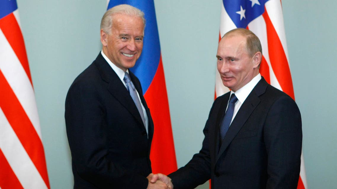 US president-elect Joe Biden, left, shakes hands with Russian Prime Minister Vladimir Putin in Moscow, Russia. (File photo:AP)