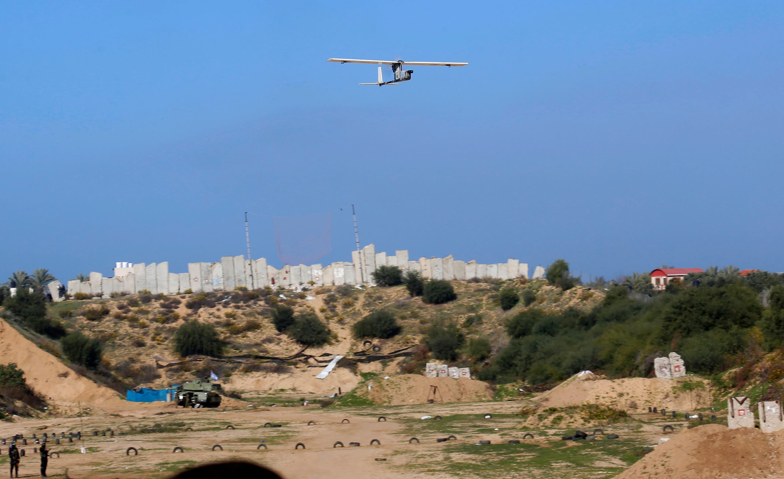 Palestinian militants use a drone to film during a military drill organized by military factions outside Gaza City, Dec. 29, 2020. (AP)