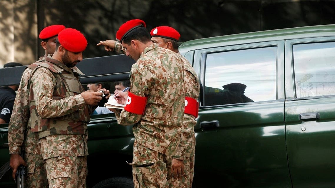 Military soldiers take note of evidence from the site of an army vehicle after two army personnel were killed by attackers on a motorcycle in Karachi, Pakistan.  (File photo: Reuters)