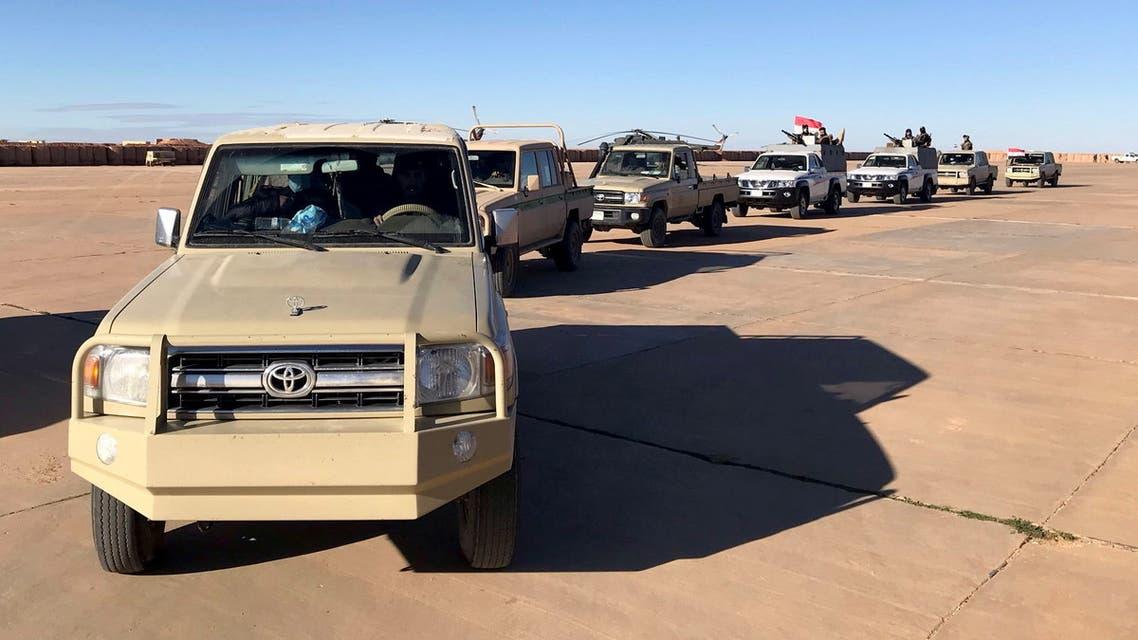 Military vehicles of Iraqi army tour at al-Waleed air base near Al-Tanf, Iraq January 18, 2021. Picture taken January 18, 2021. REUTERS/John Davison