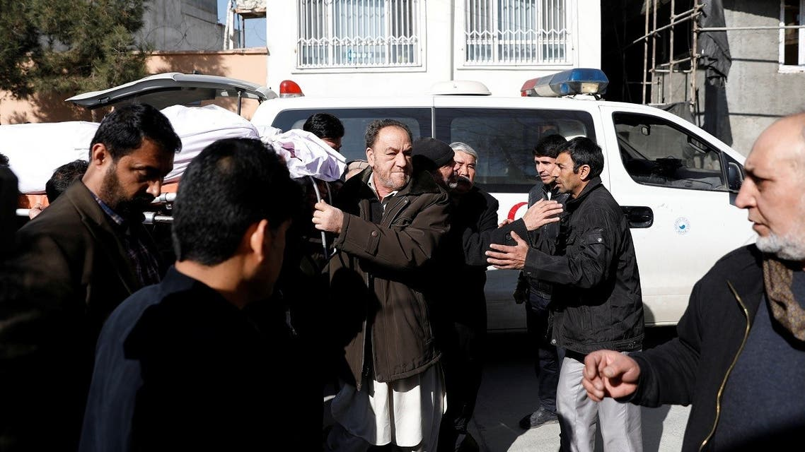 Relatives carry the body of one of the female judges shot dead by unknown gunmen in Kabul, Afghanistan, on January 17, 2021. (Reuters)