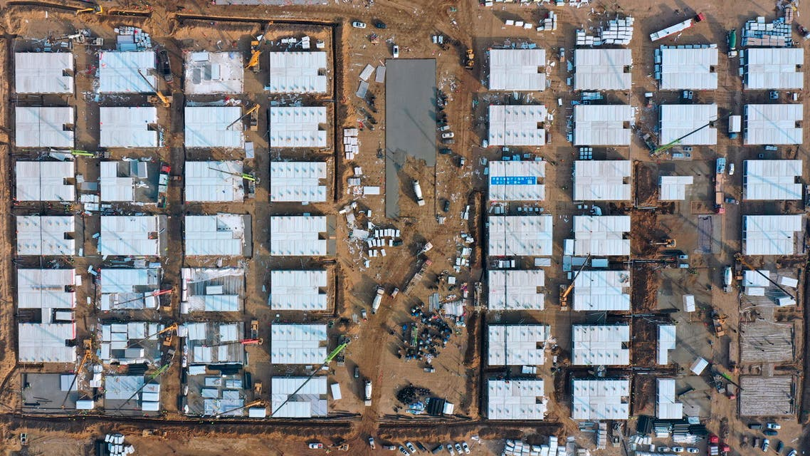 In this aerial photo released by China's Xinhua News Agency, workers build a large centralized quarantine facility capable of holding several thousand people in Shijiazhuang in northern China's Hebei Province. (AP)