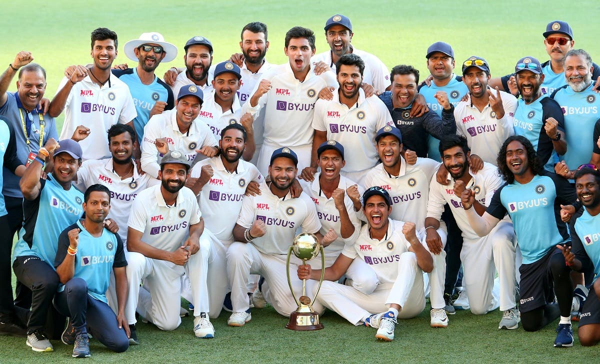The Indian cricketers pose for a celebratory team photo  after winning on day five of the fourth test match between Australia and India at the Gabba in Brisbane, Australia, on January 19, 2021. (Reuters)