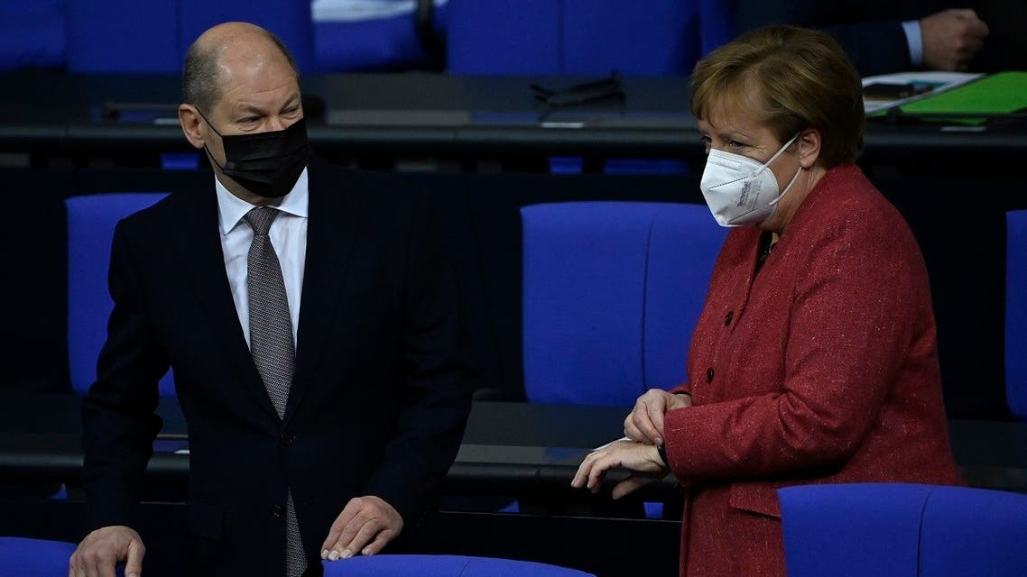 German Chancellor Angela Merkel and German Finance Minister and Vice-Chancellor Olaf Scholz arrive for a debate at the Bundestag in Berlin on December 9, 2020. (Tobias Schwarz/AFP)
