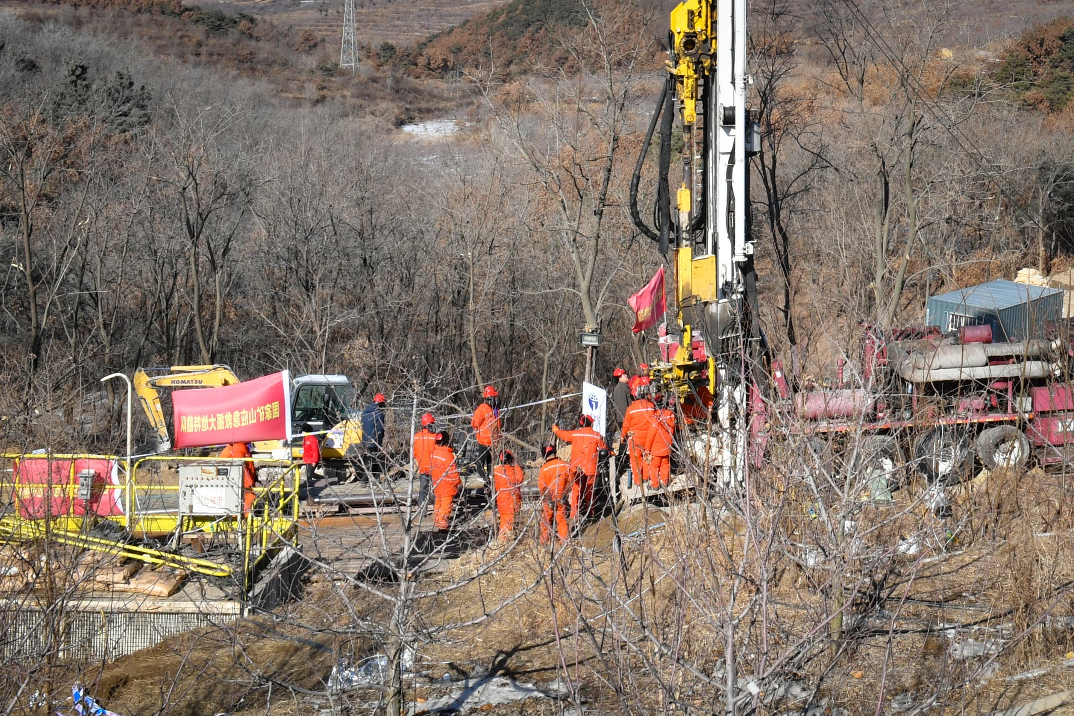 This photo taken on January 13, 2021 shows rescuers working at the site of gold mine explosion where 22 miners were trapped.