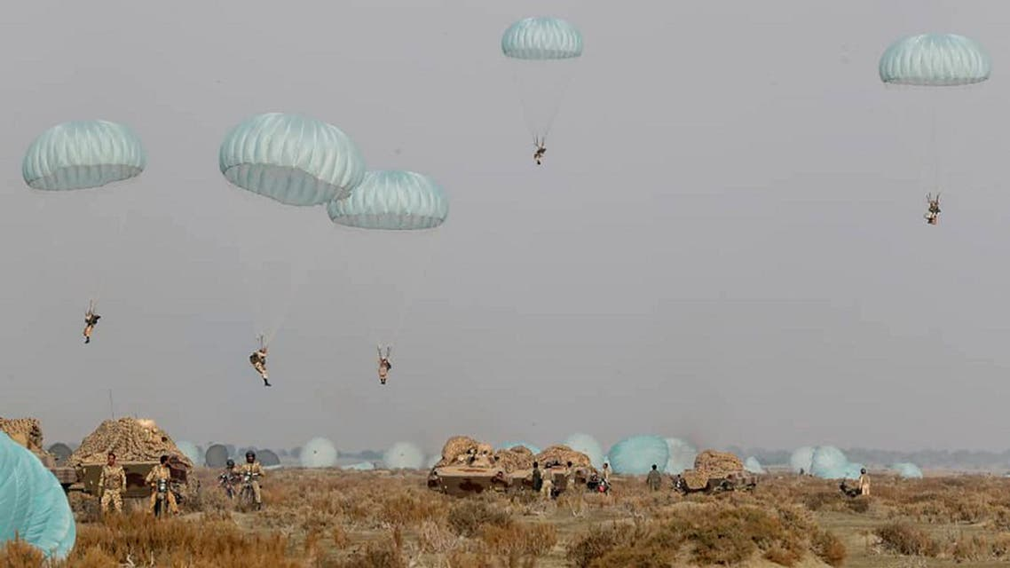 In this photo released on Tuesday, Jan. 19, 2021, by the Iranian Army, shows paratroopers parachuting during a military drill. (AP)