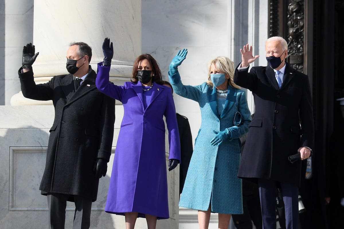 Vice President-elect Kamala Harris and President-elect Joe Biden with their spouses wave as they arrive at the Capitol for the inauguration on January 20, 2021. (AFP)