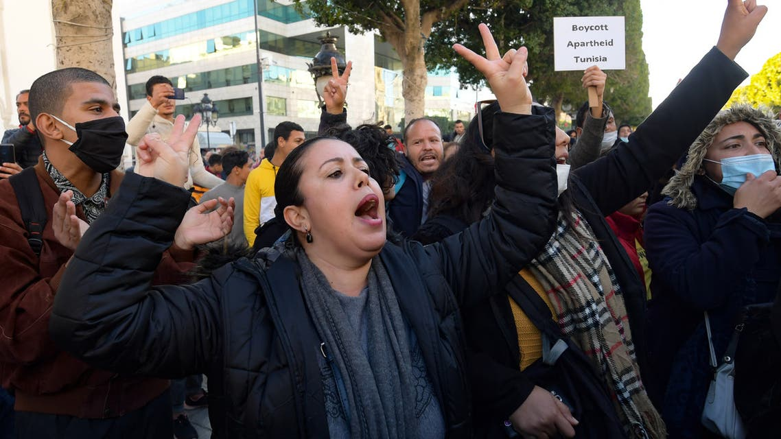 Tunisian protesters shout slogan during an anti-government demonstration on the Habib Bourguiba avenue in the capital Tunis, on January 20, 2021.
