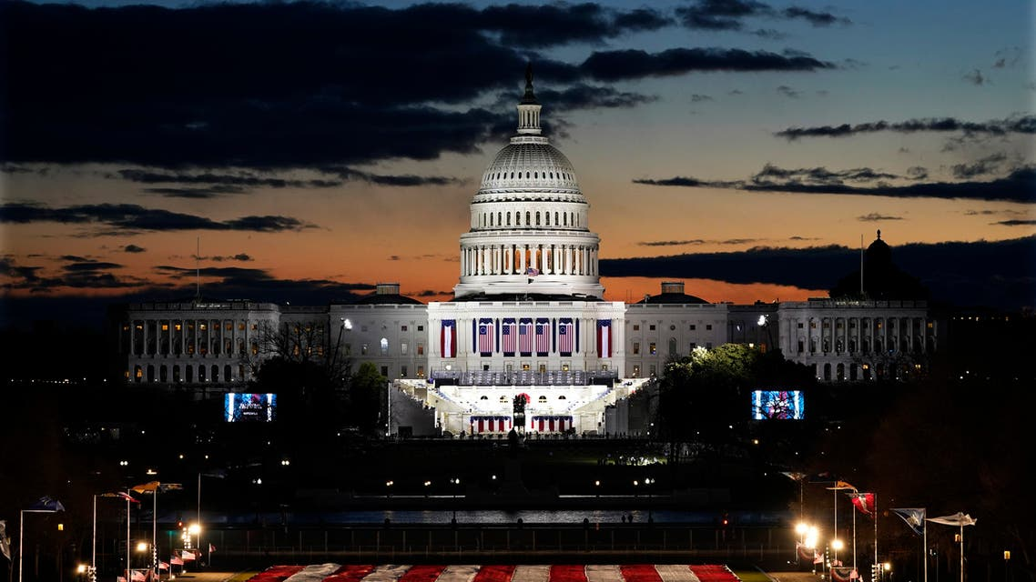 Capitol Building and stage for the swearing-in is lit as events get underway for President-elect Joe Biden's inauguration ceremony, Wednesday, Jan. 20, 2021, in Washington. (AP)