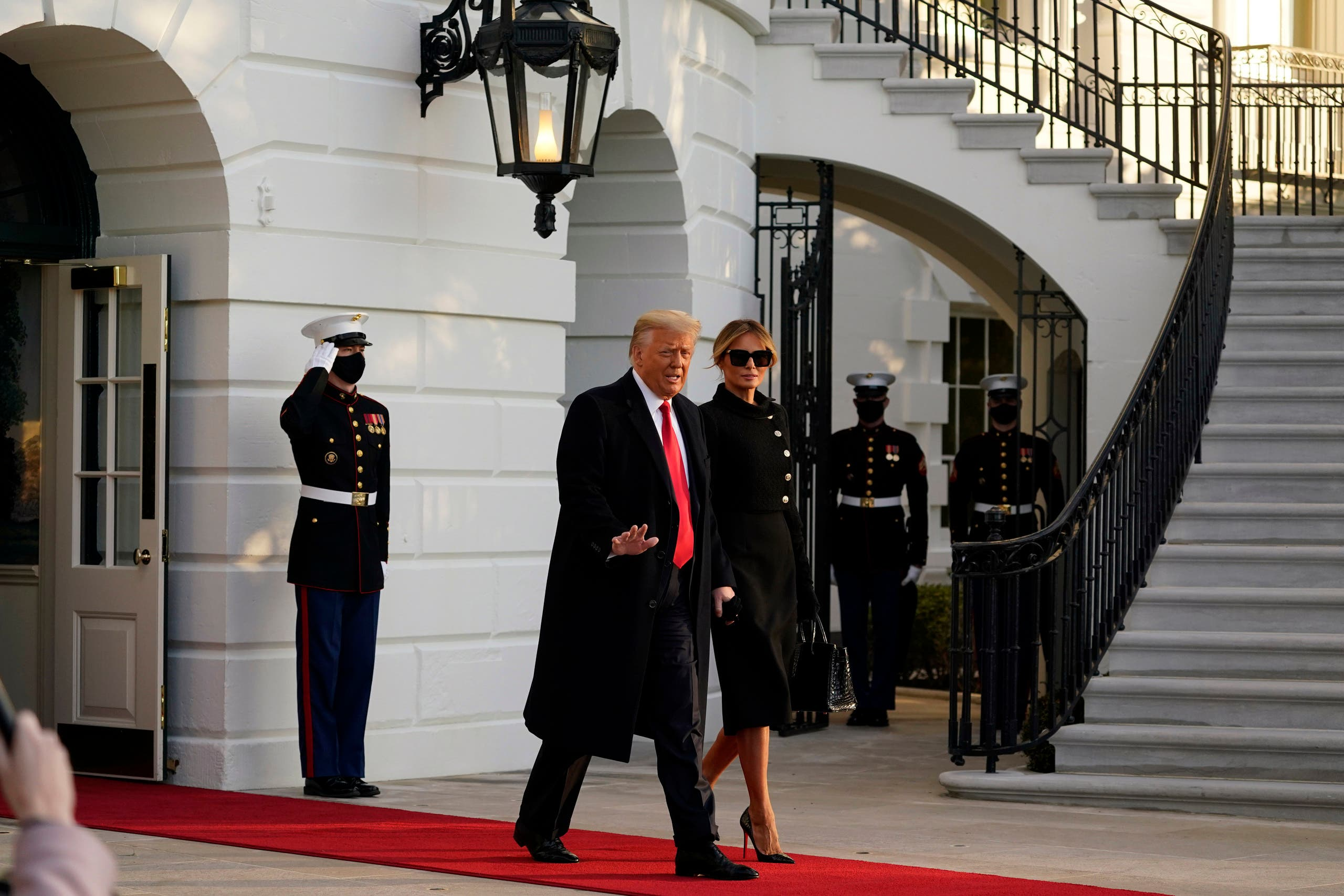 President Donald Trump and first lady Melania Trump walk to board Marine One on the South Lawn of the White House, Wednesday, Jan. 20, 2021, in Washington. (File photo: AP)