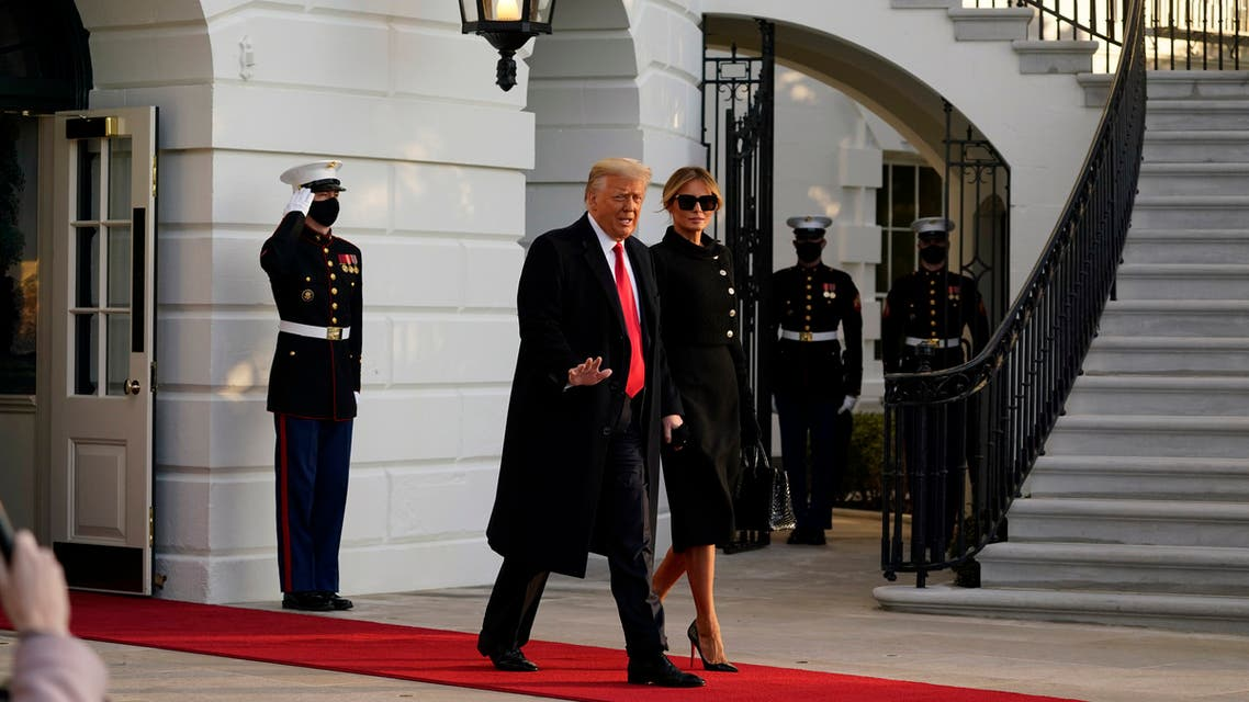 President Donald Trump and first lady Melania Trump walk to board Marine One on the South Lawn of the White House, Wednesday, Jan. 20, 2021, in Washington. (AP)